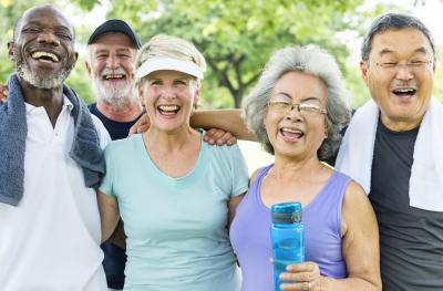 Group of smiling retirees wearing exercise clothes.