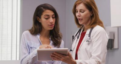 Young woman meeting with a doctor
