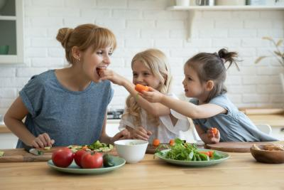 Mother and daughters eating healthy
