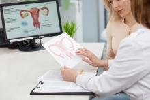 Woman looking at cervical health report