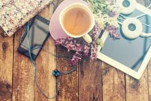 Cup of coffee among electronic devices