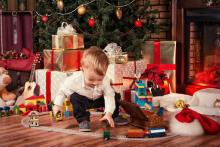 Child playing with toys on Christmas day