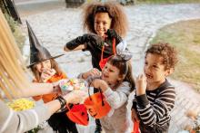 Children Trick or Treating in Halloween costumes