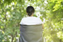 Woman in a wheelchair in the park