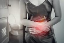 Woman with abdominal pain outside bathroom